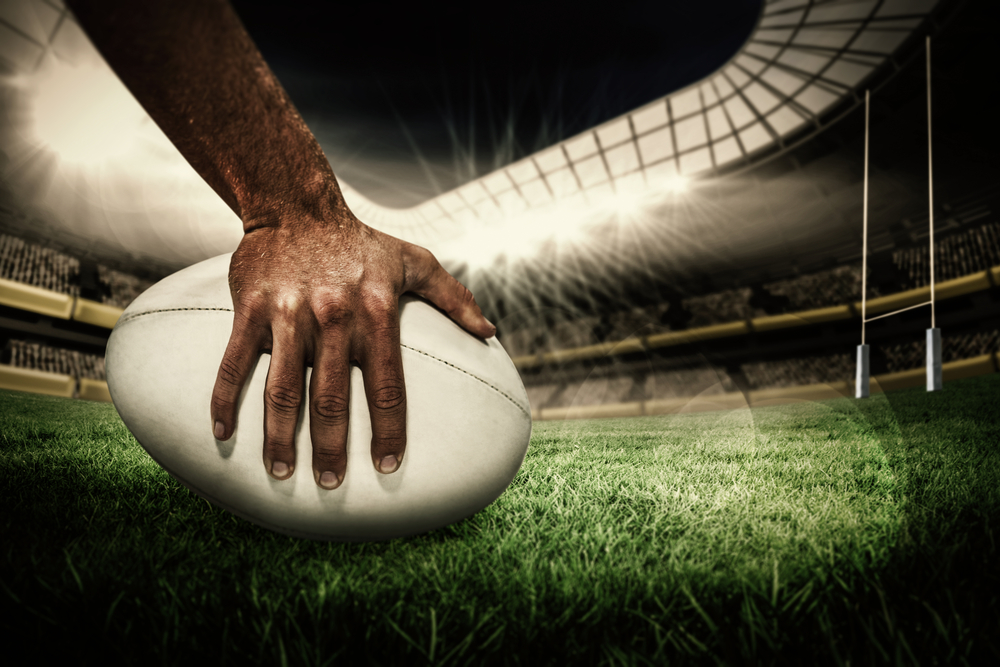 Hand on rugby ball